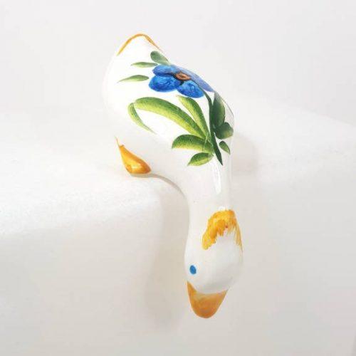 Modigliani papera curiosa fiore azzurro